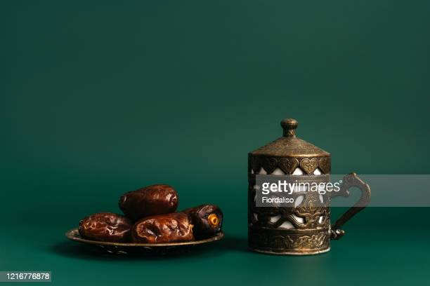 turkish metal coffee cup with lid and saucer with dates - eid al adha fotografías e imágenes de stock