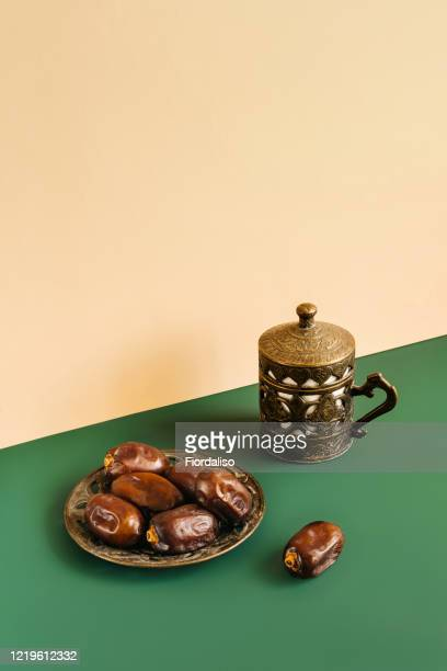 turkish metal coffee cup with lid and saucer with dates - written date stock pictures, royalty-free photos & images