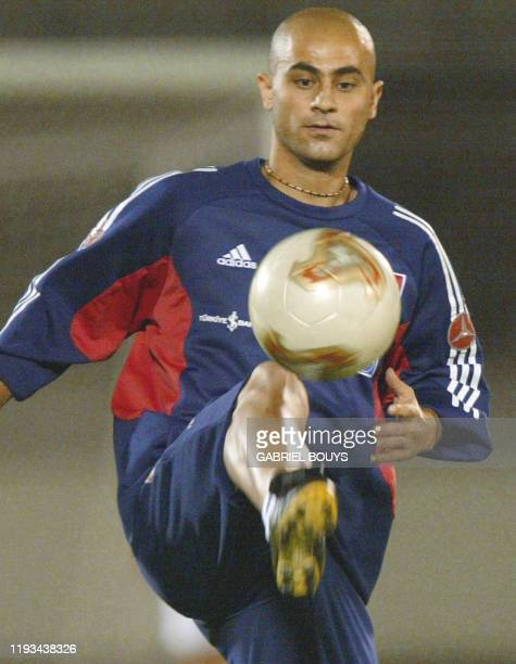 Turkish midfielder Hasan Sas plays with a soccer ball during a training session 24 June 2002 at Komaba soccer stadium near Saitama two days ahead of...