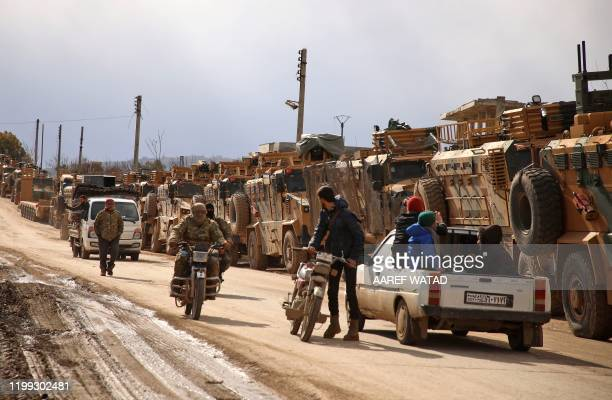 Turkish military convoy is pictured in the village of al-Mastumah, about seven kilometres south of the city of Idlib on February 8, 2020.