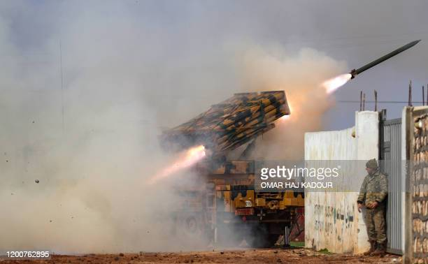 Turkish military mobile rocket launcher fires from a position in the countryside of the Syrian province of Idlib towards Syrian government forces'...