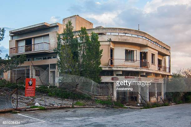 Turkish military sign is seen in front of abandoned houses in the Varosha quarter on January 5, 2017 in Famagusta, Cyprus. Prior to the Turkish...