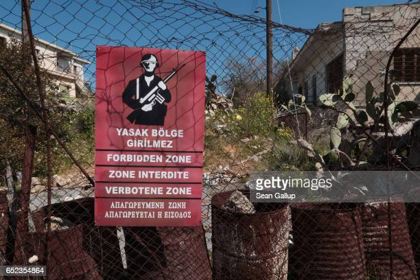 """Turkish military sign marks the fence of the """"Forbidden Zone"""" of Varosha district on March 6, 2017 in Famagusta, Cyprus. Hundrds of buildings inside..."""