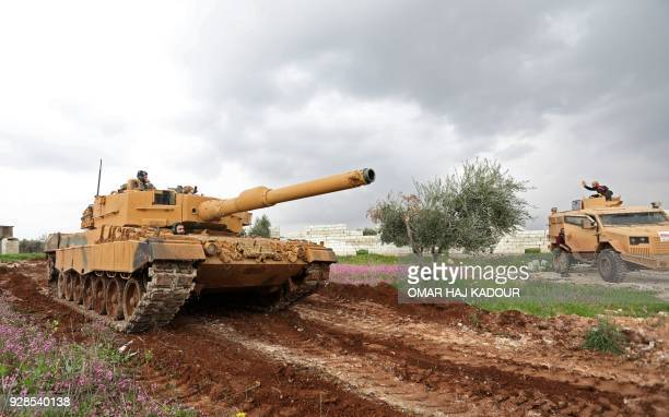 A Turkish military tank is seen during battles between Turkishled forces and Kurdish fighters on the outskirts of the town of Jandairis in the region...