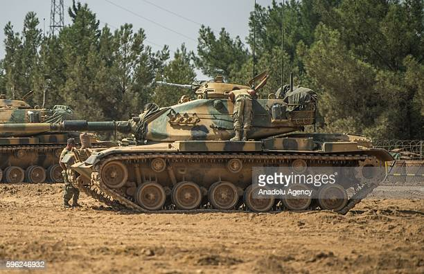Turkish military tanks and armored personnel carriers are seen at the Karkamis district of Turkey's Gaziantep during the Operation Euphrates Shield...