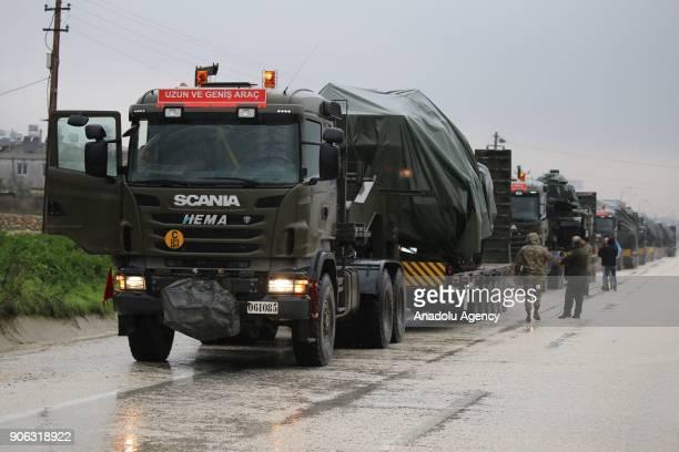 Turkish military trucks deploy tanks to reinforce the border units in Antakya district of Hatay Turkey on January 18 2018