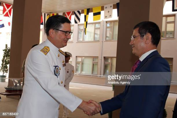 Turkish Minister of Defence Nurettin Canikli shakes hands with ViceAdmiral Adnan Ozbal during a handover ceremony in Ankara Turkey on August 22 2017...