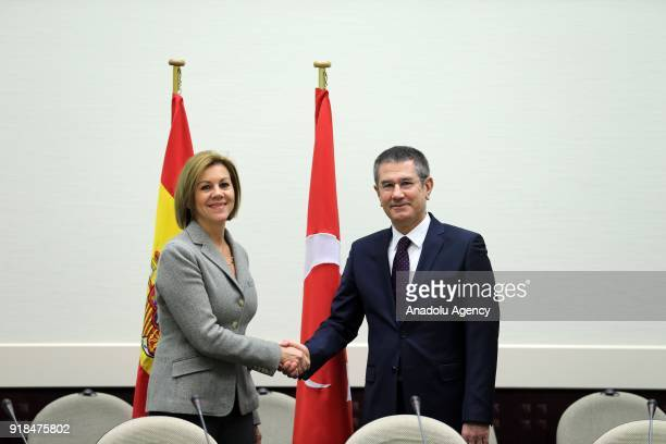 Turkish Minister of Defense Nurettin Canikli and Spanish Minister of Defence Maria Dolores de Cospedal shake hands as they pose for a photo within...