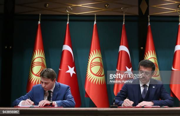 Turkish Minister of Economy Nihat Zeybekci and his Kyrgyz counterpart sign agreements between two countries ahead of the joint press conference of...