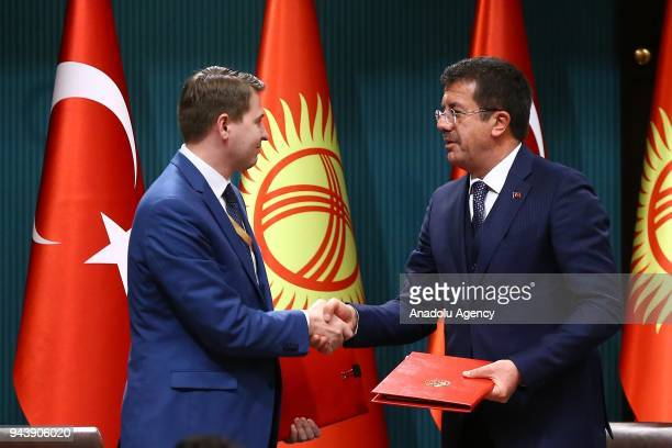 Turkish Minister of Economy Nihat Zeybekci and his Kyrgyz counterpart Artem Novikov shake hands after signing cooperation agreements between two...