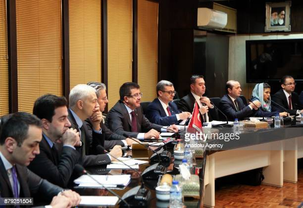 Turkish Minister of Economy Nihat Zeybekci and Iranian Minister of Industry Mine and Trade Mohammad Shariatmadari attend the 26th session of...