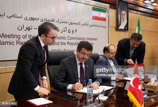 Turkish Minister of Economy Nihat Zeybekci and Iranian Minister of Industry Mine and Trade Mohammad Shariatmadari sign the agreement between Turkey...