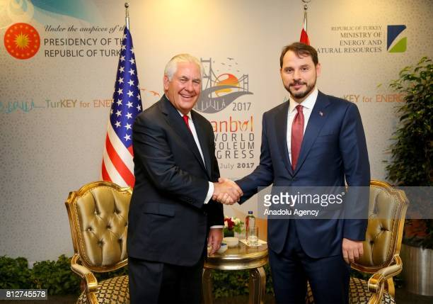 Turkish Minister of Energy and Natural Resources Berat Albayrak and US Secretary of State Rex Tillerson shake their hands during their meeting within...
