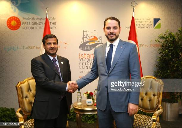Turkish Minister of Energy and Natural Resources Berat Albayrak and Yemeni Minister of Oil and Minerals Saif alShareef shake their hands during their...