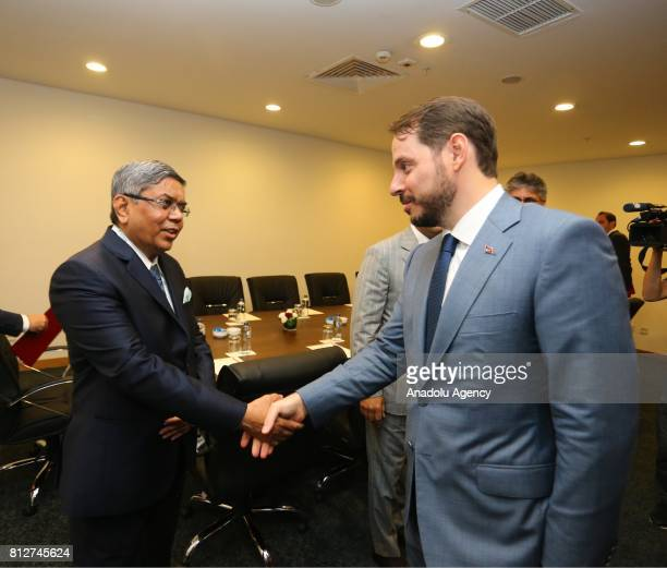 Turkish Minister of Energy and Natural Resources Berat Albayrak and Tulsi Tanti the founder of Suzlon Energy shake their hands during their meeting...