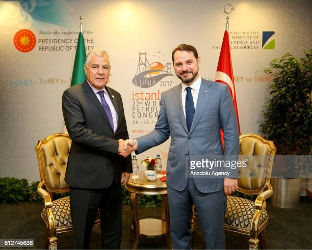 Turkish Minister of Energy and Natural Resources Berat Albayrak and Algeria's Energy Minister Mustapha Guitouni shake their hands during their...
