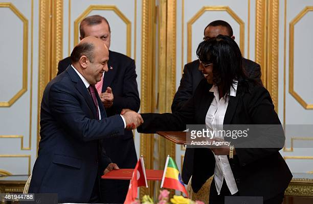 Turkish Minister of Science, Industry and Technology Fikri Isik shake hands after signing a cooperation protocol between Turkey and Ethiopia in Addis...