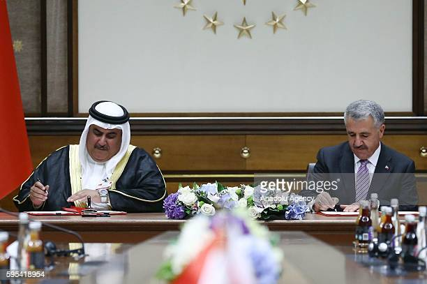 Turkish Minister of Transport, Maritime and Communication, Ahmet Arslan and Bahraini Shaikh Khalid bin Ahmed Al-Khalifa sign an agreement during an...
