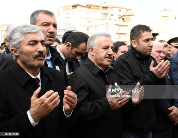 Turkish Minister of Transport Maritime and Communication Ahmet Arslan prays during the funeral ceremony of First Lieutenant Erdem Mut who was...