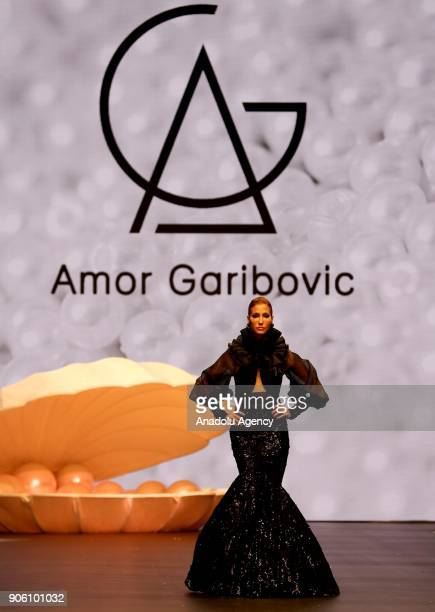 Turkish model Cagla Sikel presents the creation of Amor Garibovic who is last year's winner of Bridal Gown Design Contest at the 12th IF Wedding...