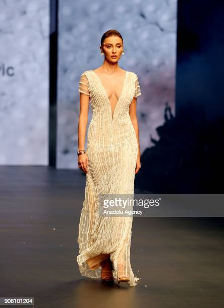 Turkish model Ozge Ulusoy presents the creation of Amor Garibovic who is last year's winner of Bridal Gown Design Contest at the 12th IF Wedding...