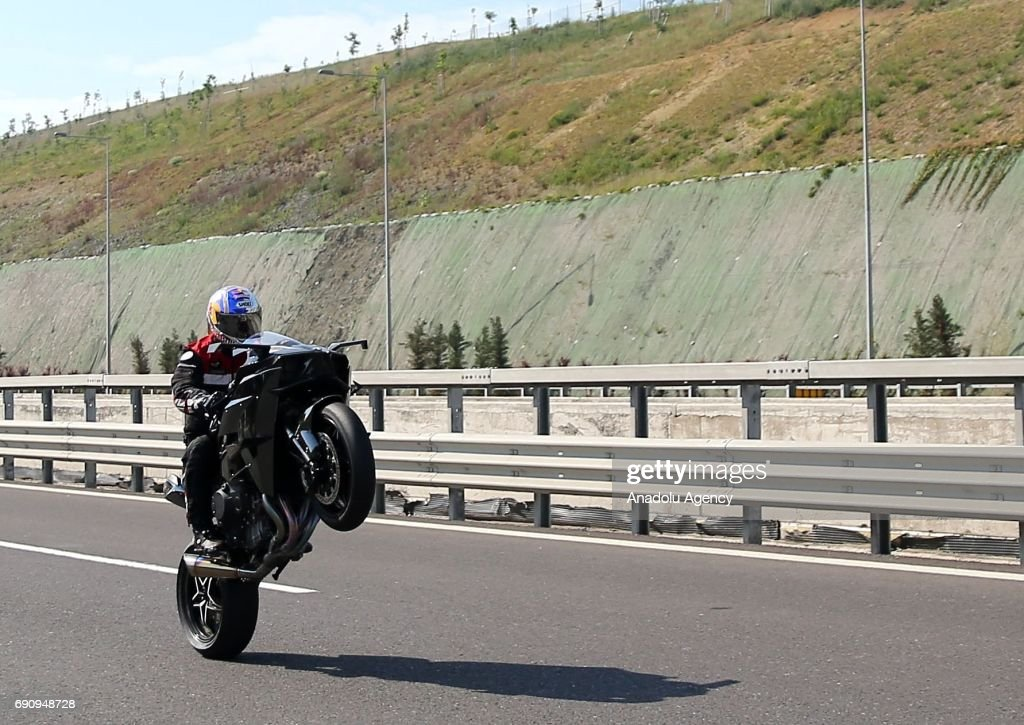 Turkish Motorcycle Racer Kenan Sofuoglu L Performs A Wheelie With Kawasaki Ninja H2R