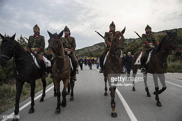 Turkish mounted gendarmes dressed as World War I Ottoman troops are seen during the dawn service at Anzac Cove in commemoration of the 100th...