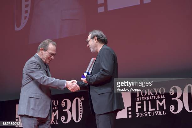 Turkish movie Director Semih Kaplanoglu receives the Tokyo Grand Prix and The Governor of Tokyo Award from the President of Jury Tommy Lee Jones for...