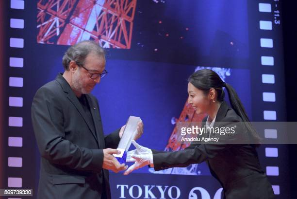 Turkish movie Director Semih Kaplanoglu receives the Tokyo Grand Prix and The Governor of Tokyo Award for the movie 'GRAIN' during the closing...