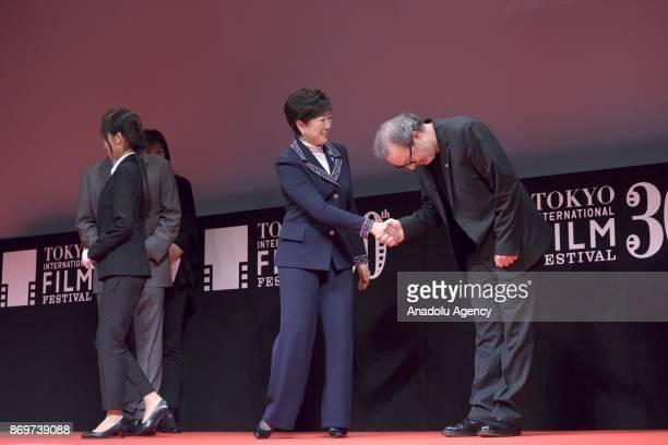 Turkish movie Director Semih Kaplanoglu shakes hand with Tokyo Governor Yuriko Koike after receiving the Tokyo Grand Prix and The Governor of Tokyo...