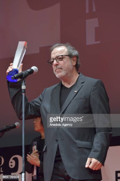 Turkish movie Director Semih Kaplanoglu speaks after receiving the Tokyo Grand Prix and The Governor of Tokyo Award for the movie 'GRAIN' during the...