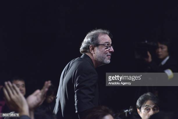 Turkish movie Director Semih Kaplanoglu walks to receive the Tokyo Grand Prix and The Governor of Tokyo Award for the movie 'GRAIN' during the...
