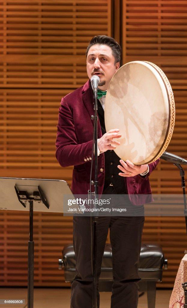 Turkish musician Ahmet Erdogdular plays a frame drum as he performs ...