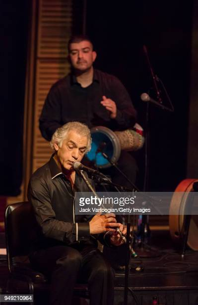 Turkish musician and composer Omar Faruk Tekbilek performs on the endblown wooden Turkish flute known as the 'ney' with his Ensemble with his son...