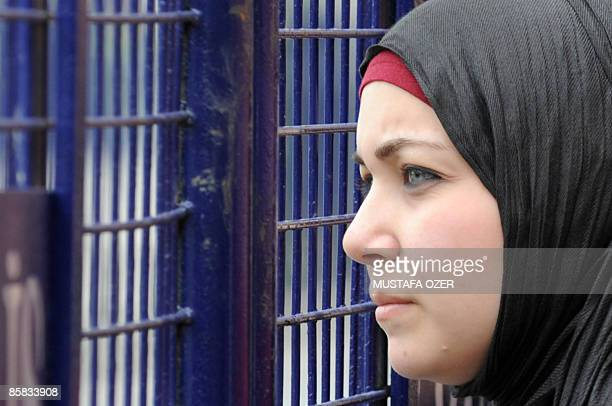 A Turkish Muslim girl waits on April 7 2009 behind a barricade near the Hagia Sophia church now a museum in Istanbul before US President Barack...