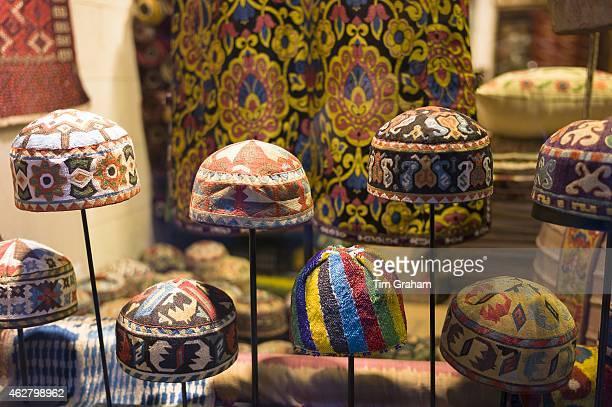 Turkish Muslim prayer caps kufi prayer skullcap or taqiyah in shop window in Istanbul, Republic of Turkey