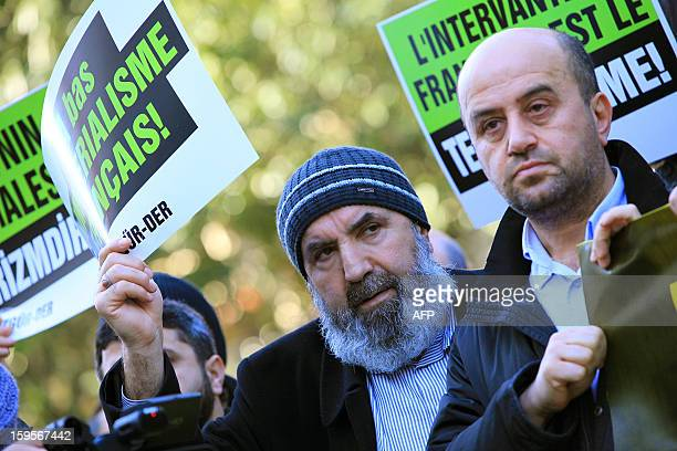 Turkish Muslims chant slogans and hold placards reading Stop to French imperialism'' during a demonstration to denounce French intervention in Mali...