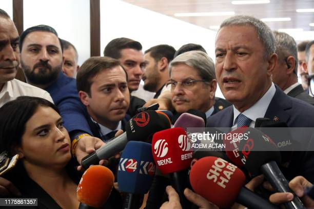 Turkish National Defence Minister Hulusi Akar makes a statement to journalists in Ankara on October 14 2019 Turkey denied on October 14 that its...