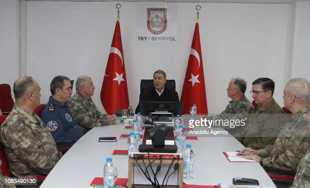 Turkish National Defense Minister Hulusi Akar attends a meeting with Turkish Chief of General Staff Yasar Guler Land Forces Commander Umit Dundar Air...