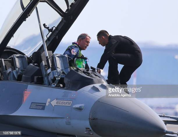 Turkish National Defense Minister Hulusi Akar gets off an F 16 fighter jet after accompanying Turkish President Recep Tayyip Erdogan's plane to the...