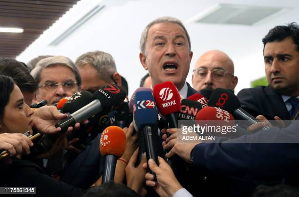 Turkish National Defense Minister Hulusi Akar makes a statement to journalists in Ankara on October 14 2019 Turkey denied on October 14 that its...