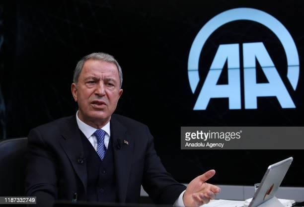 Turkish National Defense Minister Hulusi Akar speaks as he is special guest of Anadolu Agency's Editors Desk in Ankara Turkey on December 9 2019