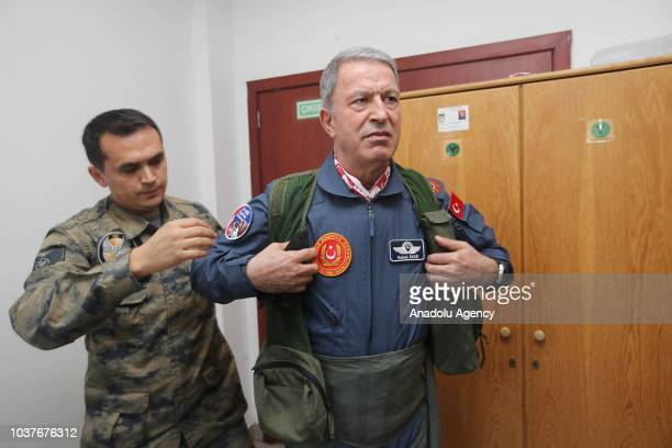 Turkish National Defense Minister Hulusi Akar takes his uniform after he arrived at the field of the 'Teknofest Istanbul' Aerospace and Technology...