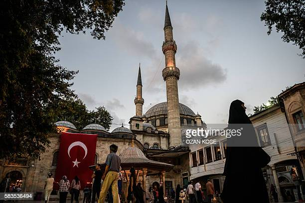 Turkish national flag is seen on Eyup sultan mosque on July 26 2016 in Eyup district in Istanbul following the failed military coup attempt of July...
