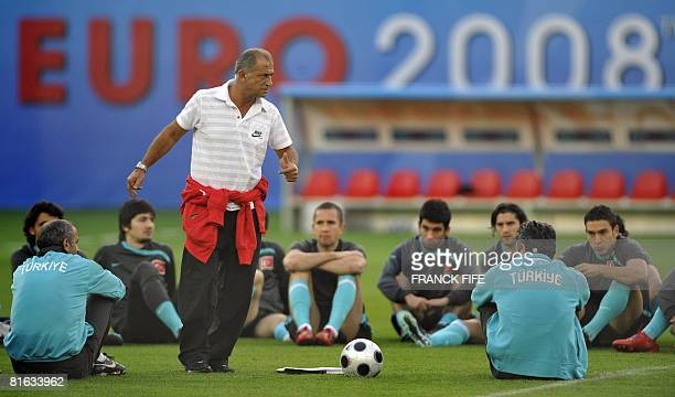 Turkish national soccer team's coach Fatih Terim gives instructions to his players during a training session in Vienna on June 19 2008 Turkey will...