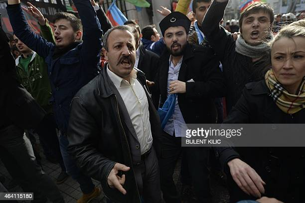 A Turkish nationalists addresses Turkish police as they face leftist protestors along Istiklal Avenue on February 22 in Istanbul A group of Turkish...