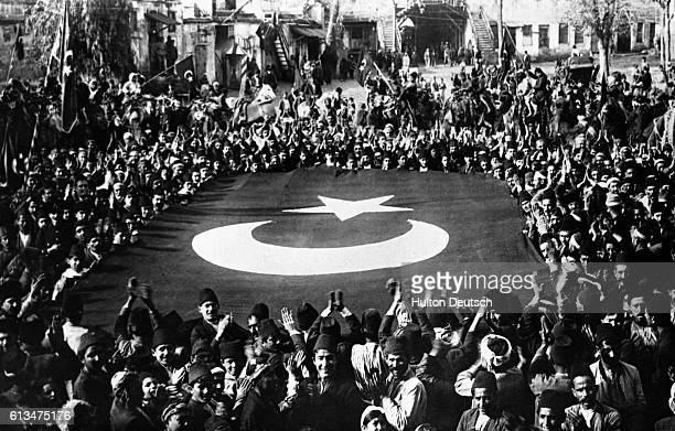 Turkish nationalists celebrate following their defeat of the Greeks at Smyrna