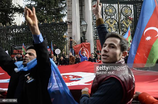 Turkish nationalists chant slogans as they face leftist protestors along Istanbul's Istiklal Avenue on February 22 2015 A group of Turkish...