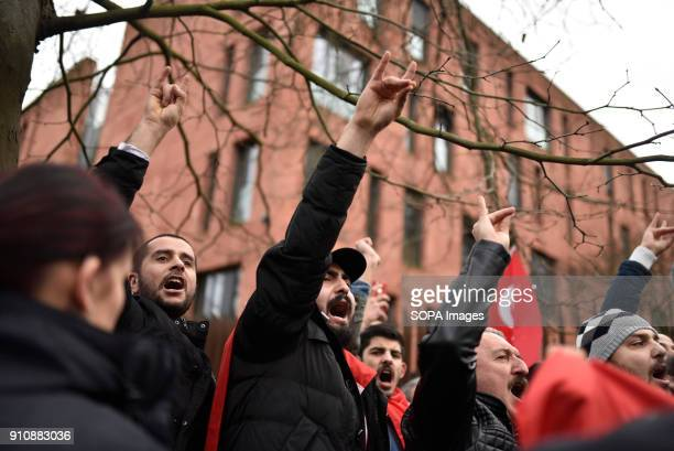 Turkish nationalists show the wolf salute during a counterdemonstration Several hundred Kurds demonstrate in front of the Turkish embassy against...