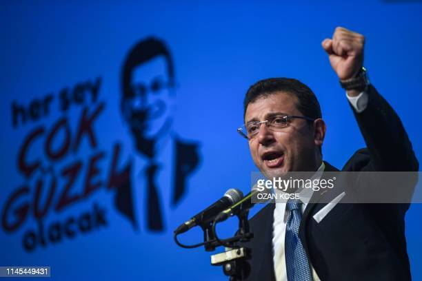 TOPSHOT Turkish opposition candidate for the Istanbul rerun for the mayor's election Ekrem Imamoglu gestures as he delivers a speech on stage during...